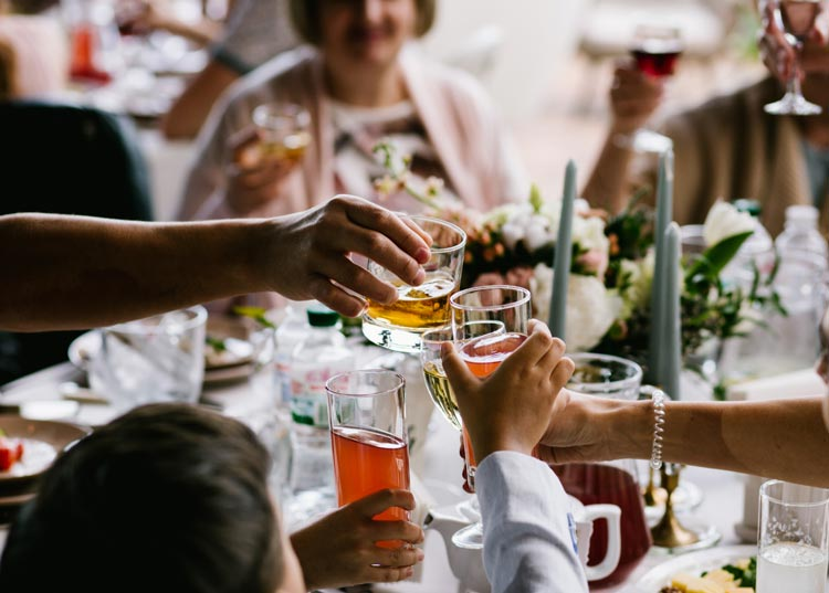 Wedding table with drinks cheering